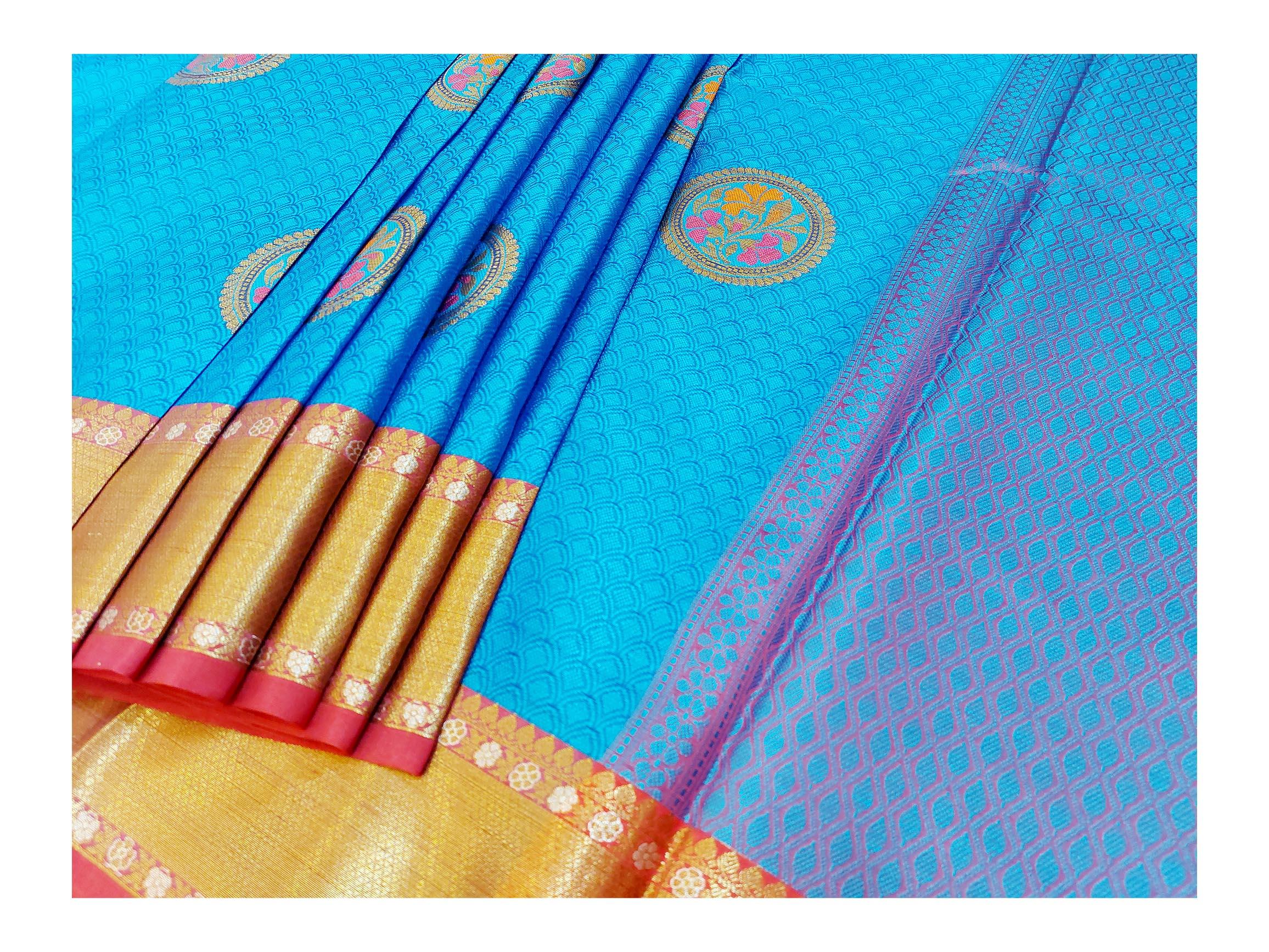 Mixture of blue silk and golden jari linen saree.